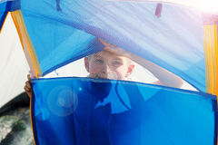 Cute small boy in a tent. He looks through the net Stock Photography