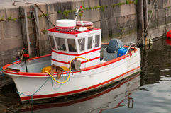 Cute small  fishboat. Mini size fish trawler with outboard motor Stock Photos