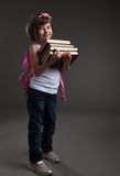 Cute small girl going to school stock images