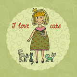 Cute small girl with her lovely cats. I love cats Stock Image
