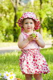 Cute small girl in the summer park. Stock Images