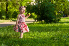 Cute small girl in the summer park. Royalty Free Stock Photography