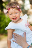 Cute small girl in the summer park. Stock Photo