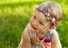 Cute small girl in the summer park. Royalty Free Stock Photo