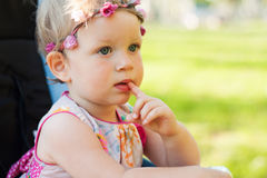 Cute small girl in the summer park. Royalty Free Stock Images