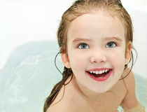 Cute small girl is taking a bath Royalty Free Stock Photos