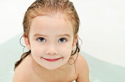 Cute small girl is taking a bath Royalty Free Stock Images