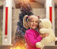 Cute small girl  with toy bear Stock Photography