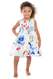 Cute small girl wearing a flowers summer dress Royalty Free Stock Image