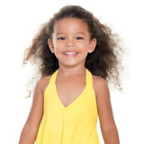 Cute small girl wearing a yellow summer dress Stock Photo