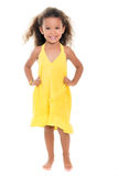 Cute small girl wearing a yellow summer dress Stock Photography