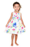 Cute small hispanic girl wearing a flowers dress Stock Photo