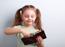 Cute Small Kid Girl Taking Dollars From Mother Wallet And Lookin Stock Photography
