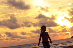 Cute small kid girl walking on the beach on bright beautiful sun Royalty Free Stock Photos
