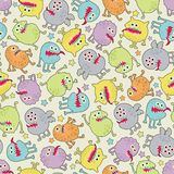 Cute small monsters seamless texture with stars. Royalty Free Stock Images