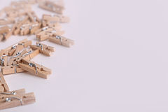 Cute small wooden clothes pegs Royalty Free Stock Image