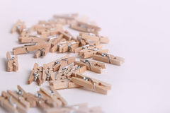 Cute small wooden clothes pegs Stock Image