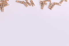Cute small wooden clothes pegs Royalty Free Stock Photography