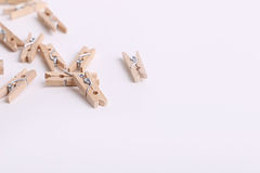 Cute small wooden clothes pegs Royalty Free Stock Images