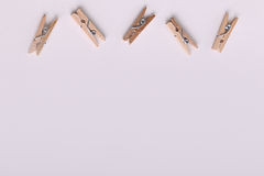 Cute small wooden clothes pegs Royalty Free Stock Photo