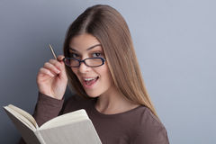 Cute smart girl is studying very well stock photos