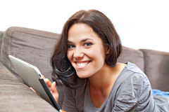 Cute smile and electronic tablet Stock Photos
