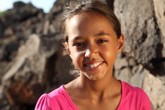 Cute smile from young mixed race girl outdoors stock photos