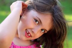 Cute Smiley Little Girl Looking Royalty Free Stock Photo