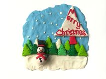 Cute smiley Snowman plasticine clay, beautiful scenery, Merry Christmas dough royalty free stock photo
