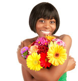 Smiling female with fresh flowers Stock Photos