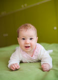 Cute smiling baby on bed Royalty Free Stock Photography