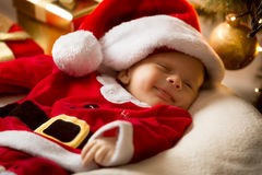 Cute smiling baby boy in Santa costume and hat Royalty Free Stock Photos