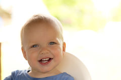 Cute smiling baby boy with 8 teeth looking at camera Stock Photos