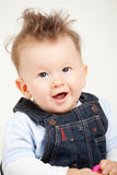Cute smiling baby with fancy haircut. In studio Stock Photos