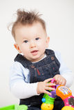 Cute smiling baby with fancy haircut. In studio Royalty Free Stock Photography