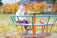 Cute smiling baby girl having fun at the playground Stock Photo