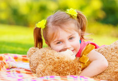 Little girl hugging soft toy Stock Image