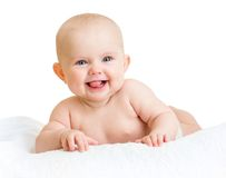 Cute smiling baby girl lying on towel isolated on Royalty Free Stock Image