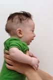 Cute smiling baby held by his mother profile view. Cute smiling baby boy held by his mother profile view Stock Images