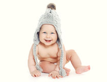 Cute smiling baby in knitted hat Stock Photos