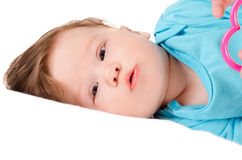 Cute smiling baby lying on the bed. Closeup portrait of a cute smiling baby lying on the bed Royalty Free Stock Photography