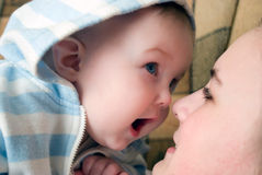 Cute smiling baby plays with loving mother Stock Photo