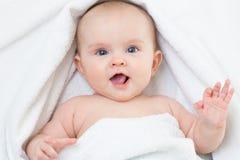 Cute smiling baby portrait lying on bathing towel. Cute baby portrait lying on bathing towel stock photo