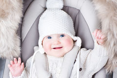 Cute smiling baby sitting in a stroller Royalty Free Stock Image