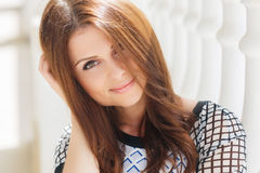 Cute smiling beautiful woman on the white terrace Royalty Free Stock Photos