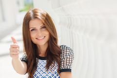 Cute smiling beautiful woman on the white terrace Royalty Free Stock Photography