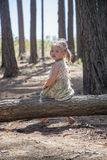 She is cute, smiling blond girl. She is happy to be in forest Stock Photos