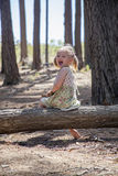 She is cute, smiling blond girl. She is happy to be in forest Royalty Free Stock Photos