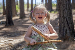 She is cute, smiling blond girl. She is happy to be in forest Stock Photography