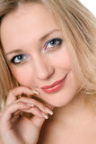 Cute smiling blond woman Stock Photography